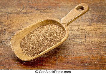 teff grain scoop - rustic wooden scoop of gluten free teff...