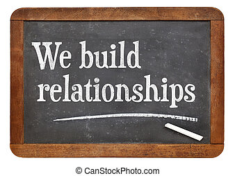 We build relationships - white chalk text on a vintage slate...