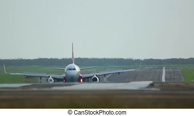 ?n the runway - Airplane taxiing on the runway,...