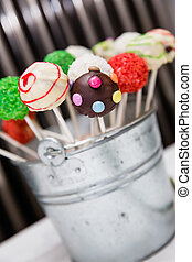 cake pops - some little cakes at a food buffet
