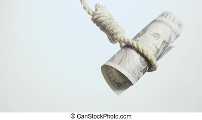 dollar bill hangman - devaluating money hanging on the rope