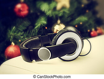 Headphones with christmas tree - Headphones resting on a...