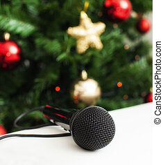 Black microphone with christmas tree - Black microphone on...