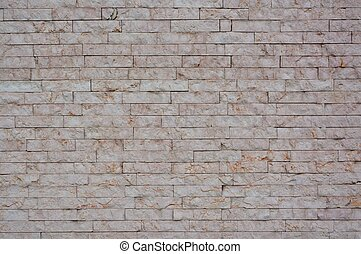 Stone wall with abstract pattern - Urban stone wall with...