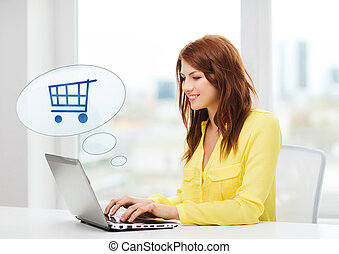 smiling woman with laptop computer shopping online - people,...