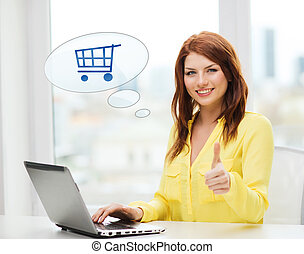 smiling woman with laptop computer shopping online -...