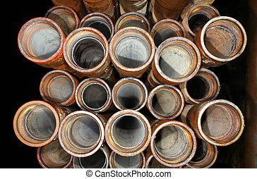 Drill pipe stacked beside an oil well in the Ecuadorian...