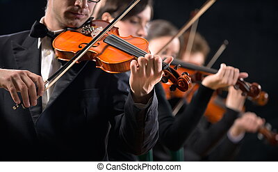 Violin orchestra performing - Violinists performing on stage...