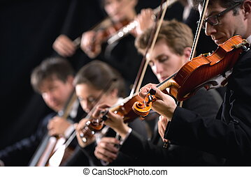 Orchestra first violin section - Symphony orchestra first...