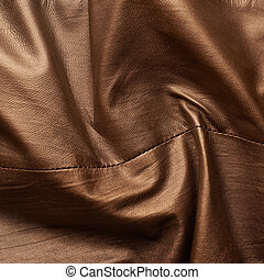 Brown leather material fragment - Brown creased leather...