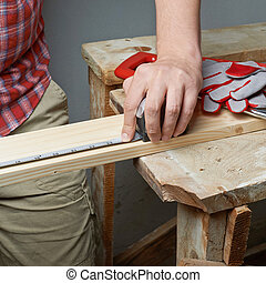 Taking the measurements of the wooden board