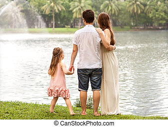 parents with daughter in park