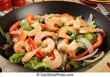 Shrimp stir fry in a wok - Closeup of shrimp stir fry in a...