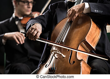 Symphony orchestra performance: celloist close-up - Cello...