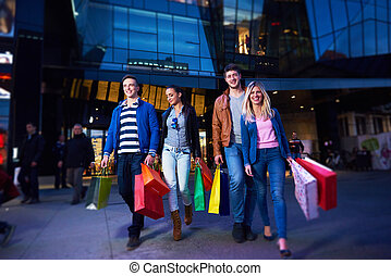 Group Of Friends Enjoying Shopping Trip Together group of...