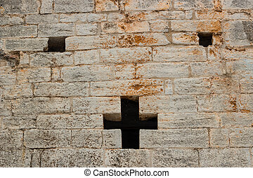 Cross shaped hole - A cross shaped hole in an old brick wall