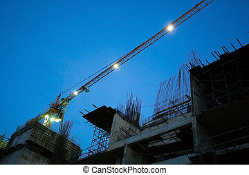 Construction site with crane working in the night