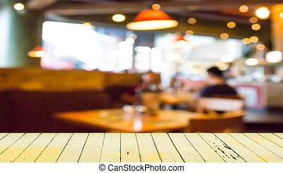 Empty wood table and blurred coffee shop background - Empty...