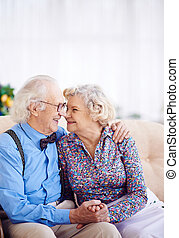 Attraction - Elegant retired couple looking at one another