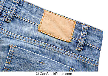 Blank leather jeans label sewed on a blue jeans on white...