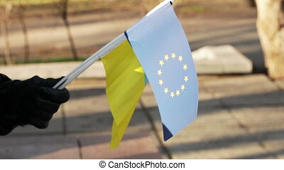 Flag EU and Ukraine - Demonstrator in the flag of the...
