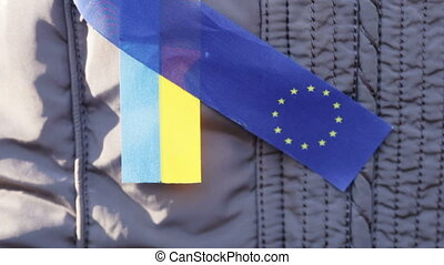 Ribbons EU and Ukraine - Demonstrator with ribbons EU and...
