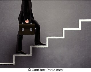 businessman walking on hand drawn stairs over grey
