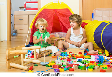 Children playing with blocks - Two siblings together playing...