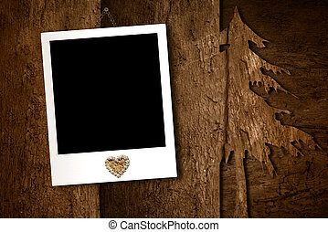 Christmas, photo frame hanging on an old wooden wall