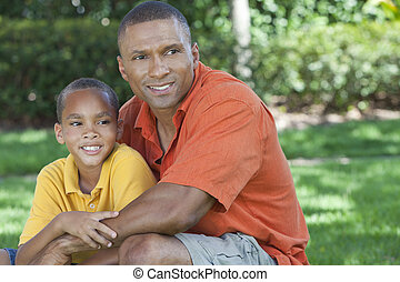 Happy African American Father and Son Family Outside