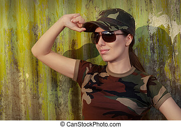 Soldier in Camouflage Saluting - Portrait of a happy...