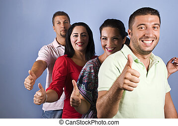 Happy friends give thumbs up in a line - Group of happy...