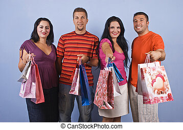 Happy friends at shopping - Group of happy friends,two...
