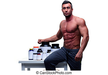 Handsome muscular man leaning on the table with sports...