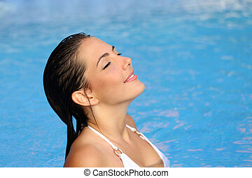 Beauty woman breathing while bathing in a pool in summer -...