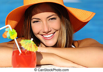 Happy woman with perfect white smile in vacations bathing in...