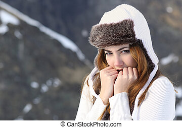 Woman going cold sheltered in winter outdoors in a snowy...