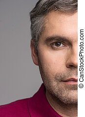 half face of adult man on grey background. grey haired male...