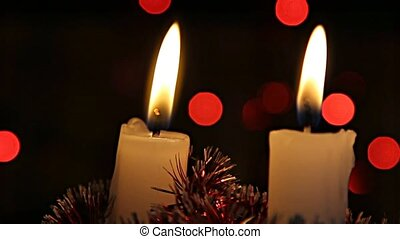 2 Christmas candles burning - Christmas candles burning on a...