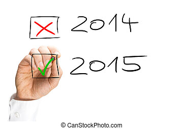 Man ticking the start of the 2015 New Year with a green tick...
