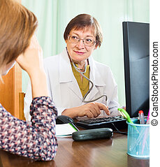 Female patient having medical consultation  at  office