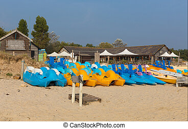 Canoes and pedalos blue and yellow - Studland knoll beach...
