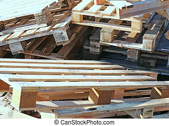 huge pile of wooden pallets piled