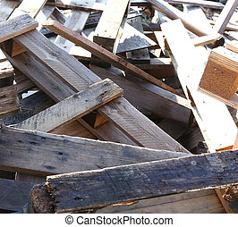 great pile of wooden pallets piled in a landfill