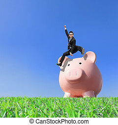 Happy Saving Money with my piggy bank - Young excited...