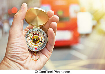 Compass in the hand on a street of London
