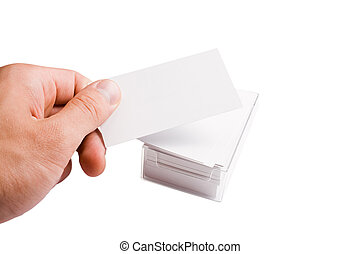 hand holding business card and a stack full of it