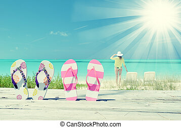 Flip-flops against ocean Great Exuma island, Bahamas