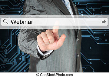 Businessman pushing virtual search bar with webinar word on...