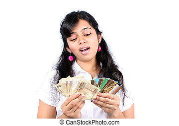 Cash or Credit - A beautiful Indian teenage girl deciding...